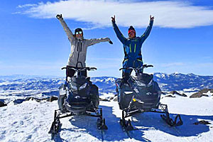 Be On Top of the Rockies on your own Snowmobile
